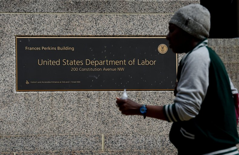 Man Walks Past Department of Labor