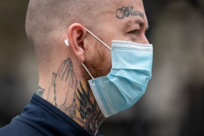 Man wears face mask walking through Westminster