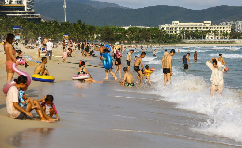 People on the beach in Sanya on China's Hainan Island, pictured on April 20, 2020.