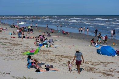 Beachgoers Galveston Beach on May 2, 2020 in Texas