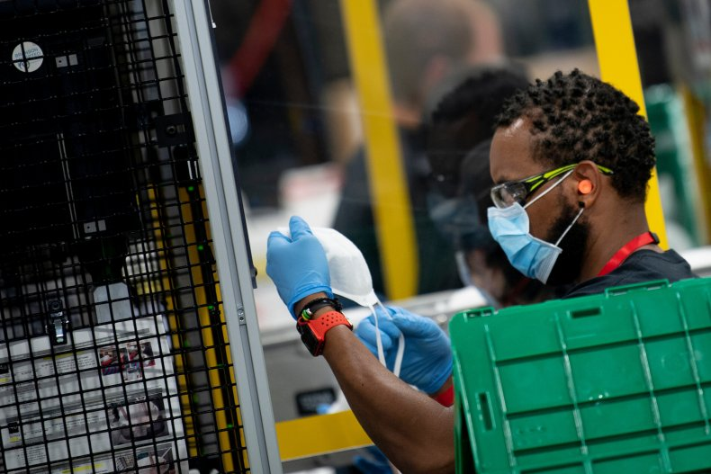 A worker at a Honeywell mask factory works on N95 masks May 5, 2020, in Phoenix, Arizona.