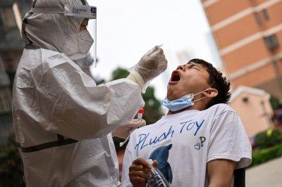WUHAN, CHINA, Coronavirus swab test reaction