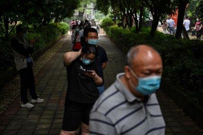WUHAN, CHINA, Coronavirus lines for swab test