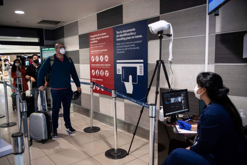 A Chile's Health Ministry worker monitors a screen of a thermal scanner to check body temperature of a passenger before boarding a flight at Santiago International Airport, in Santiago, on April 20, 2020MARTIN BERNETTI/AFP/GETTY