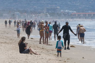Californians pictured in Manhattan Beach, California on May 13, 2020