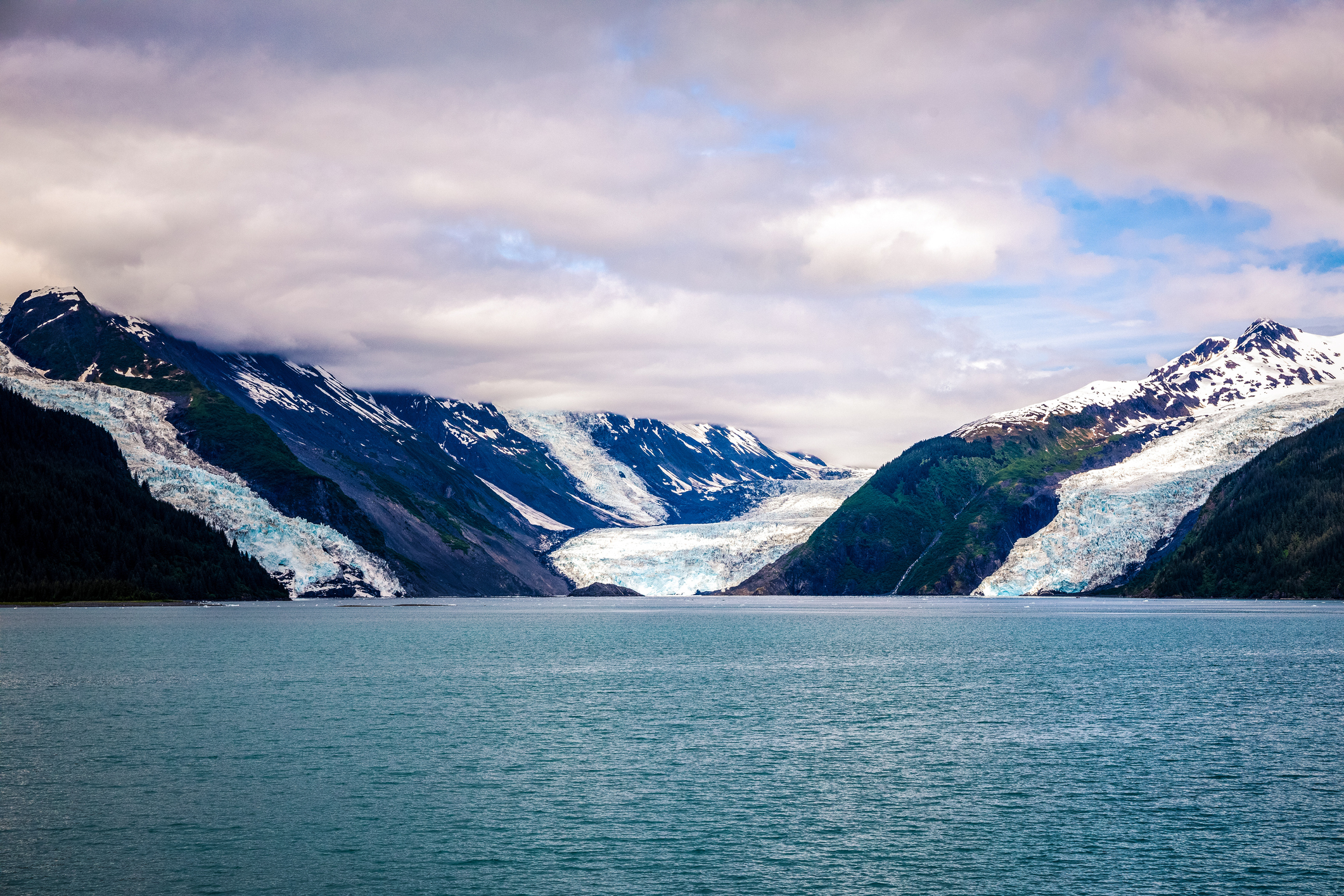 Alaskan mountain slope has become unstable and may collapse producing a tsunami hundreds of feet high, scientists warn