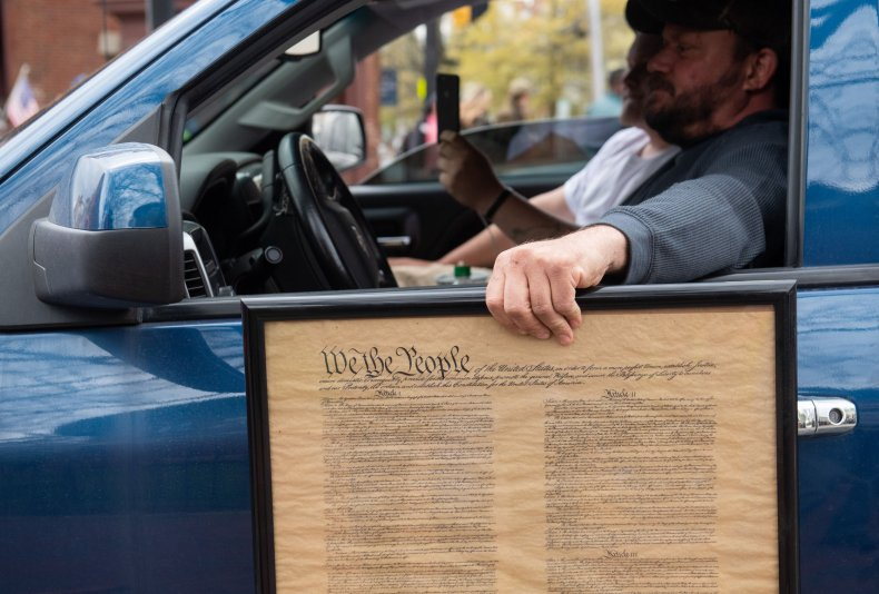 Maryland protester holding U.S. Constitution