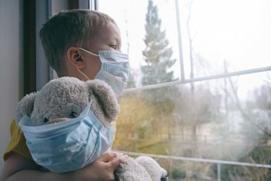 Child and teddy bear with masks