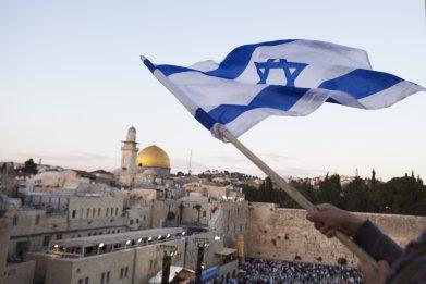 Israel flag waving in Old City Jerusalem