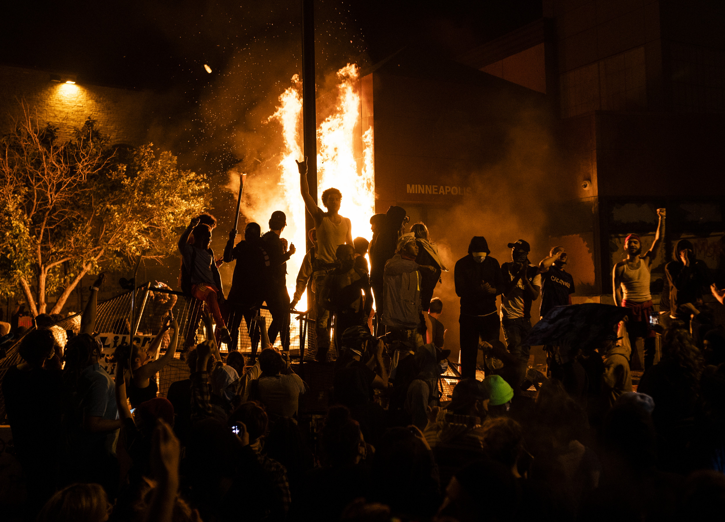 Photos Show Floyd Protests Escalate to Violence, Flames...