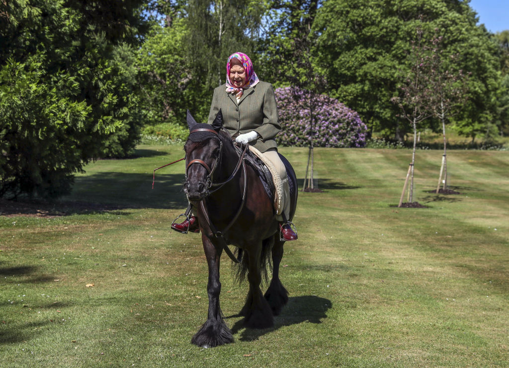 """Queen Elizabeth II's horse riding photos could be """"helpful"""" as U.K. emerges from lockdown, royal insiders hope"""