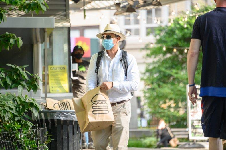 Man wears protective masks New York restaurant