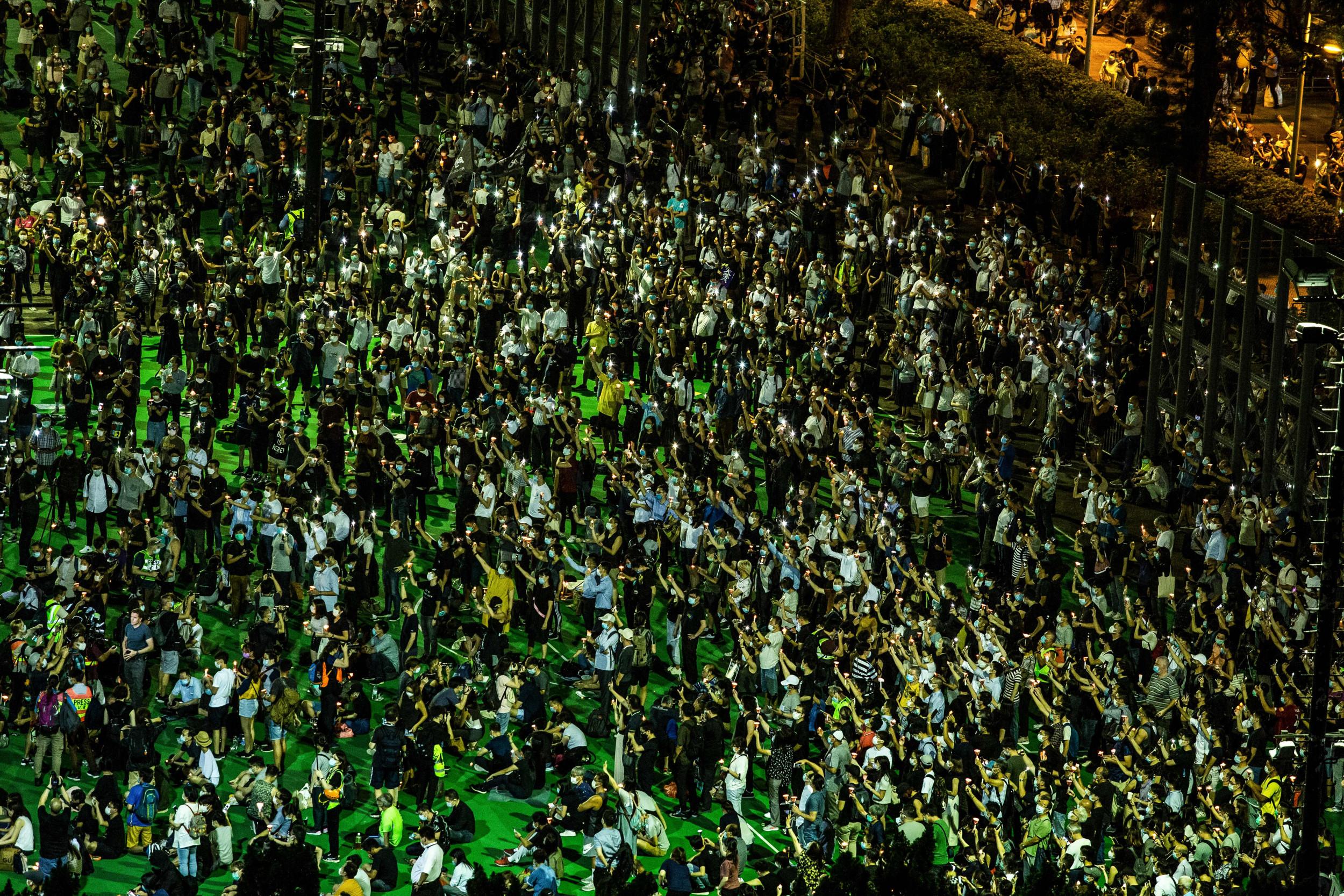 As China gloats over U.S. protests, Hong Kong police allow thousands to defy Tiananmen vigil ban