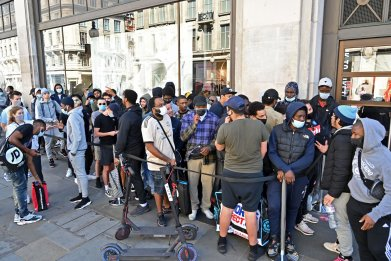 People queue outside Nike in central London