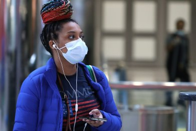 A traveler wears a mask in airport