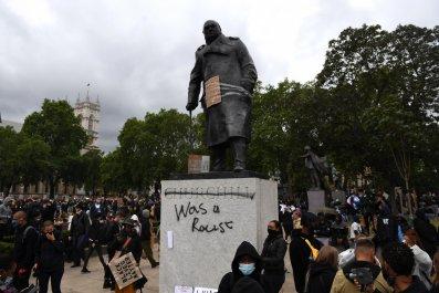 Winston Churchill statue with graffiti