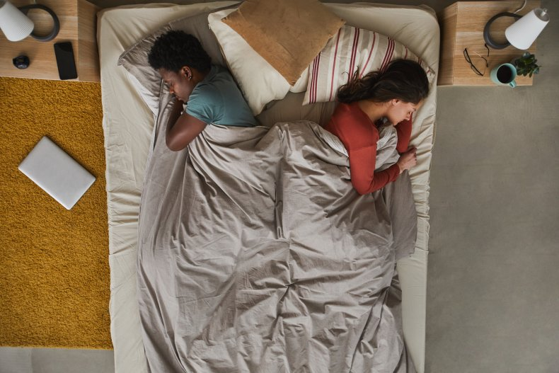 sleep, bed, couple, getty, stock,