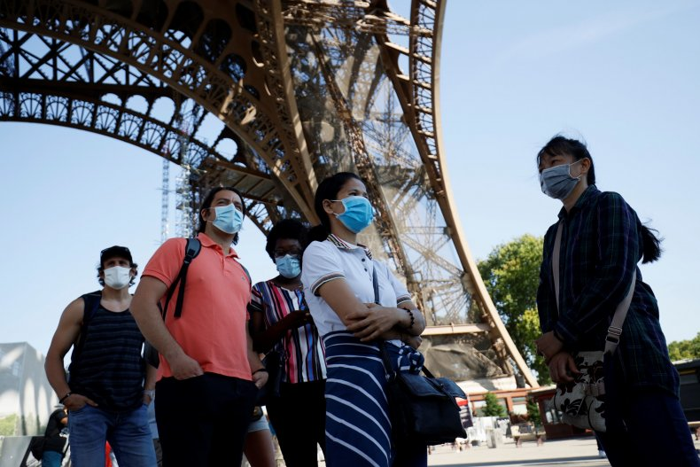 Visitors wear face masks in Paris