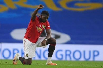 Paul Pogba takes knee before Premier League