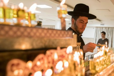 Orthodox Jew lighting candles during Chanukah