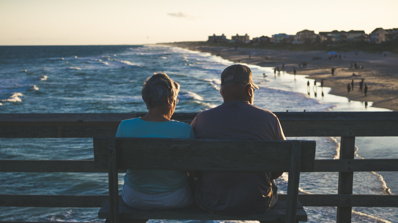 Couple sitting on a bench retirement