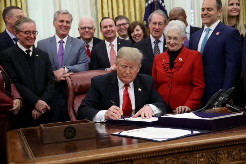 President Donald Trump signing First Step Act