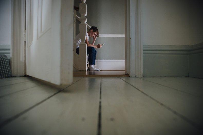 Boy Sits Alone
