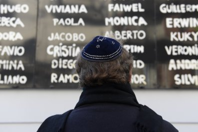 Jewish Argentine man praying on 23rd anniversary