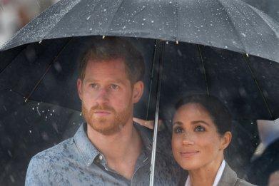 Prince Harry and Meghan Markle in Rain
