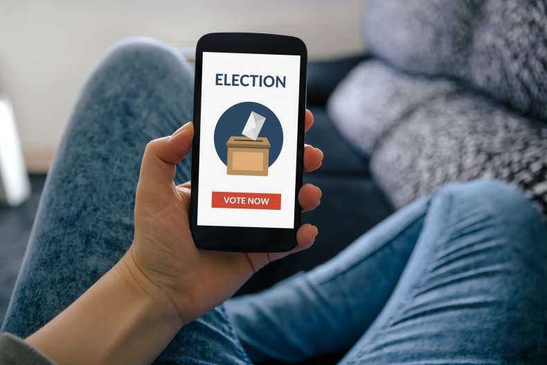 A mobile phone displays a voting app