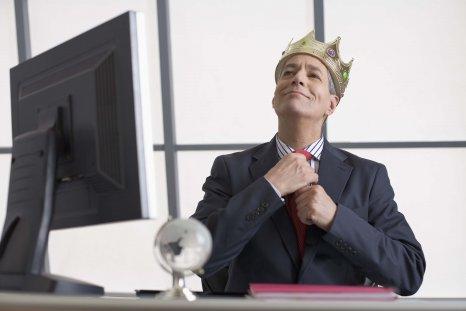 Smug Businessman Wearing Crown