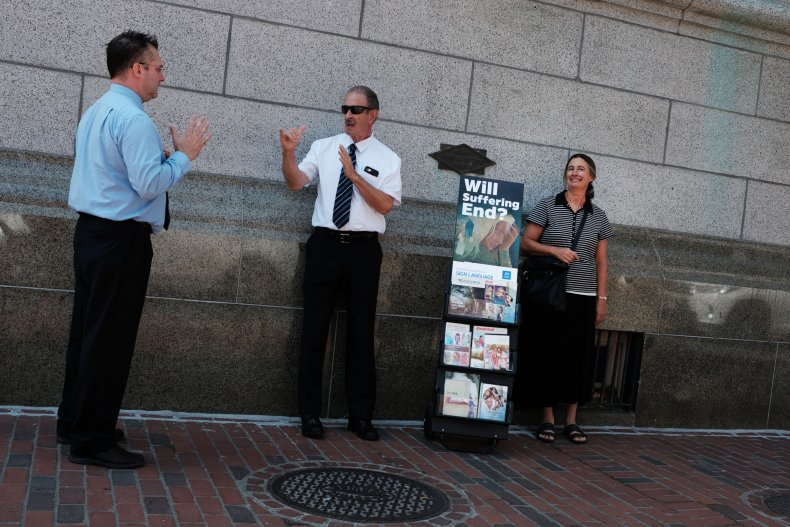 a group of Jehovah's Witnesses stand on