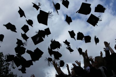 Students throw up their mortarboards