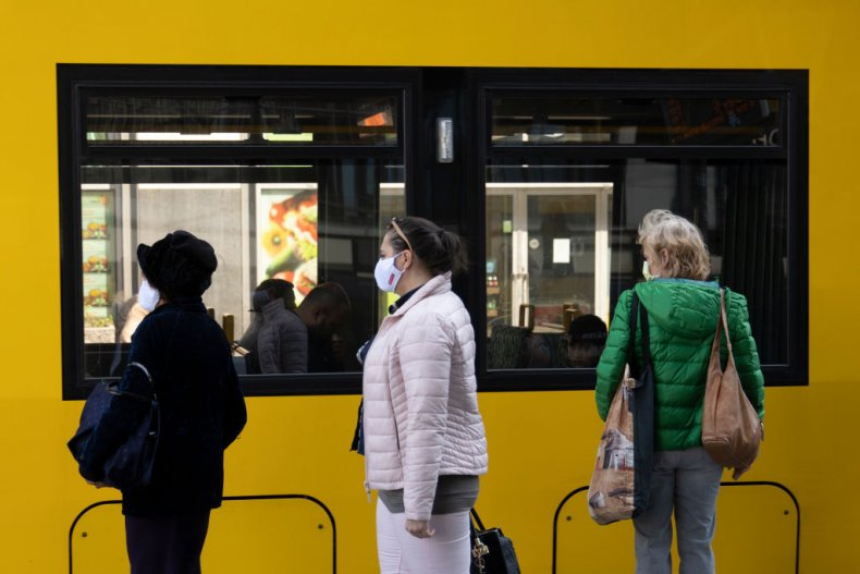 Passengers in line for German bus