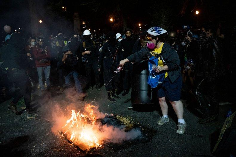 Protestors burning items in Portland