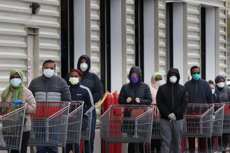 Customers wear face masks while shopping