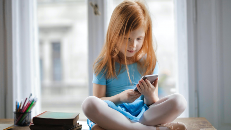 Child holding a phone