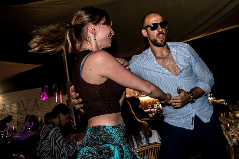 Italy restaurant dancing couple August 2020