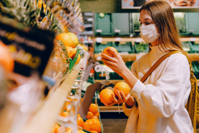 Woman wearing a mask while at supermarket