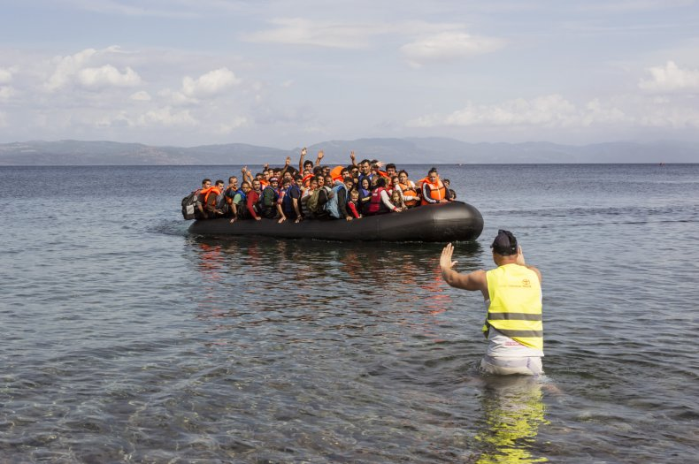 rubber boat packed with refugees