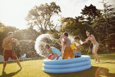Family playing with water gun