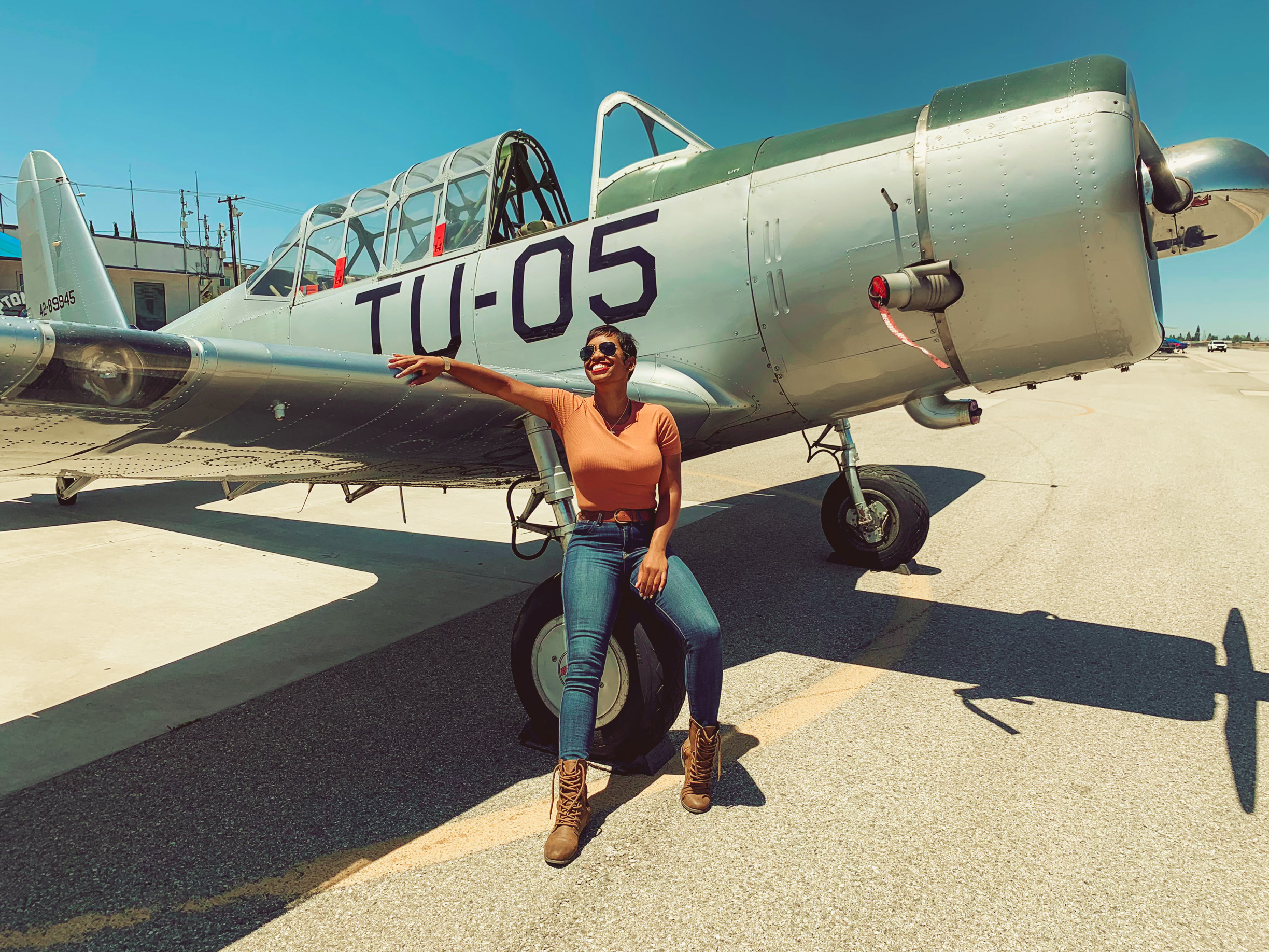 Kellee Edwards by a Vultee BT-13 Aircraft