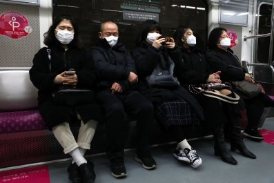 Seoul South Korea subway masked passengers