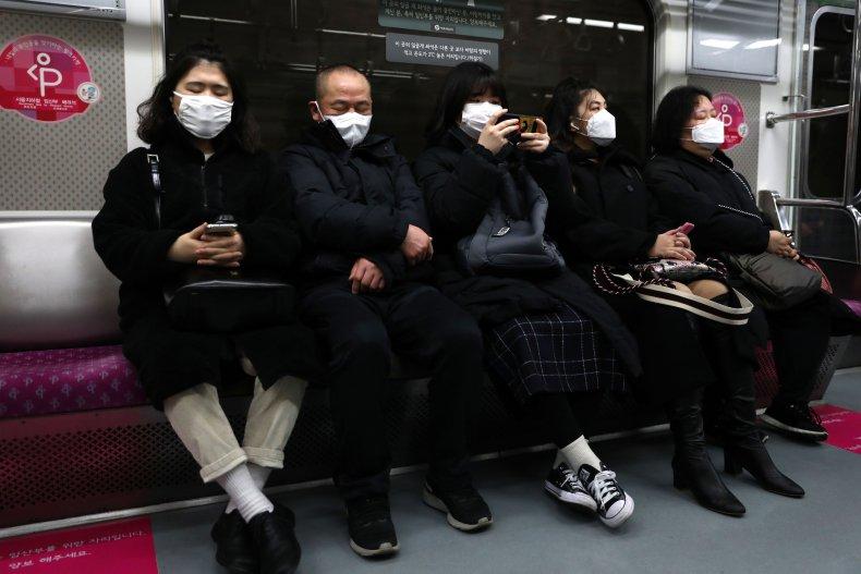 Seoul South Korea subway masked passengers