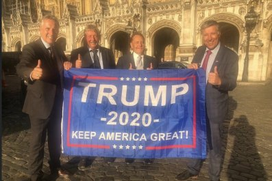 DUP MPs hold Trump banner