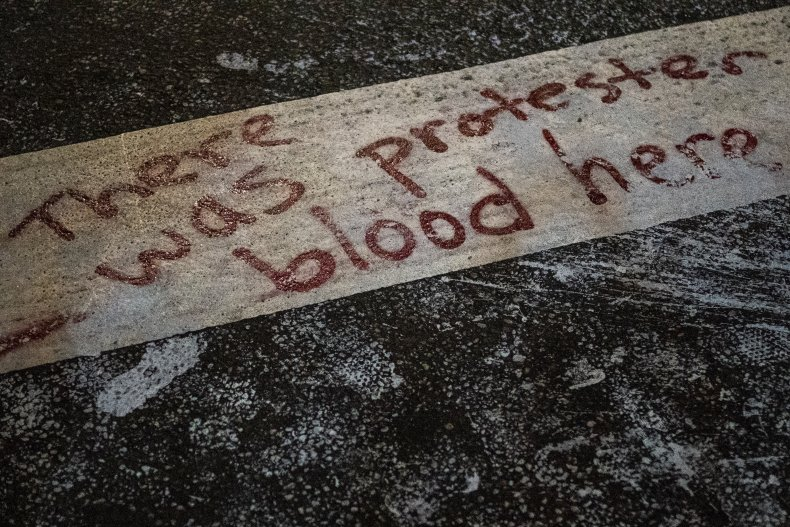 """""""Protester Blood"""" Sign"""