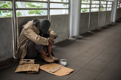 Homeless Person with Signs