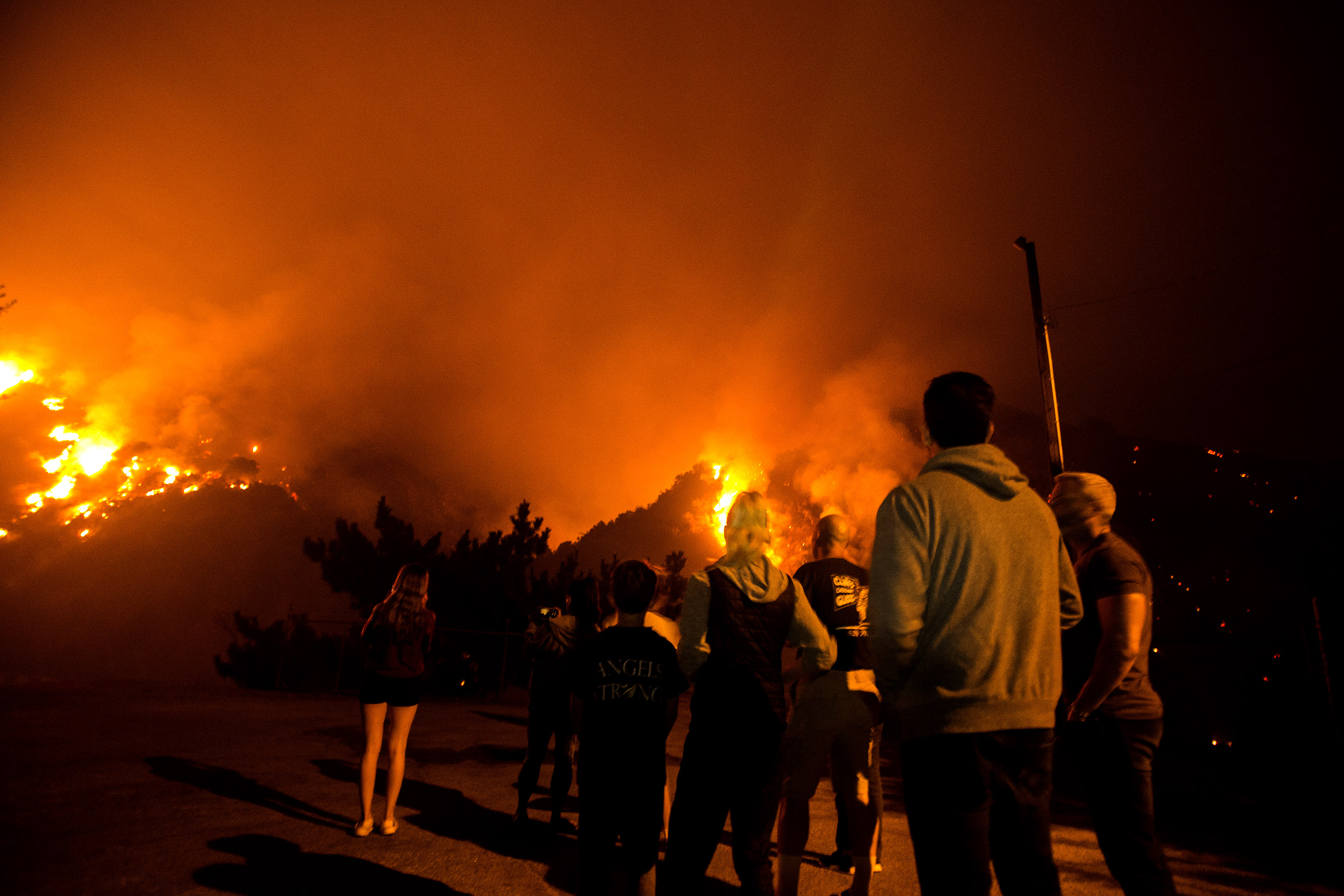 Oregon, scorched by fire, braces for floods as California blaze prompts more evacuations