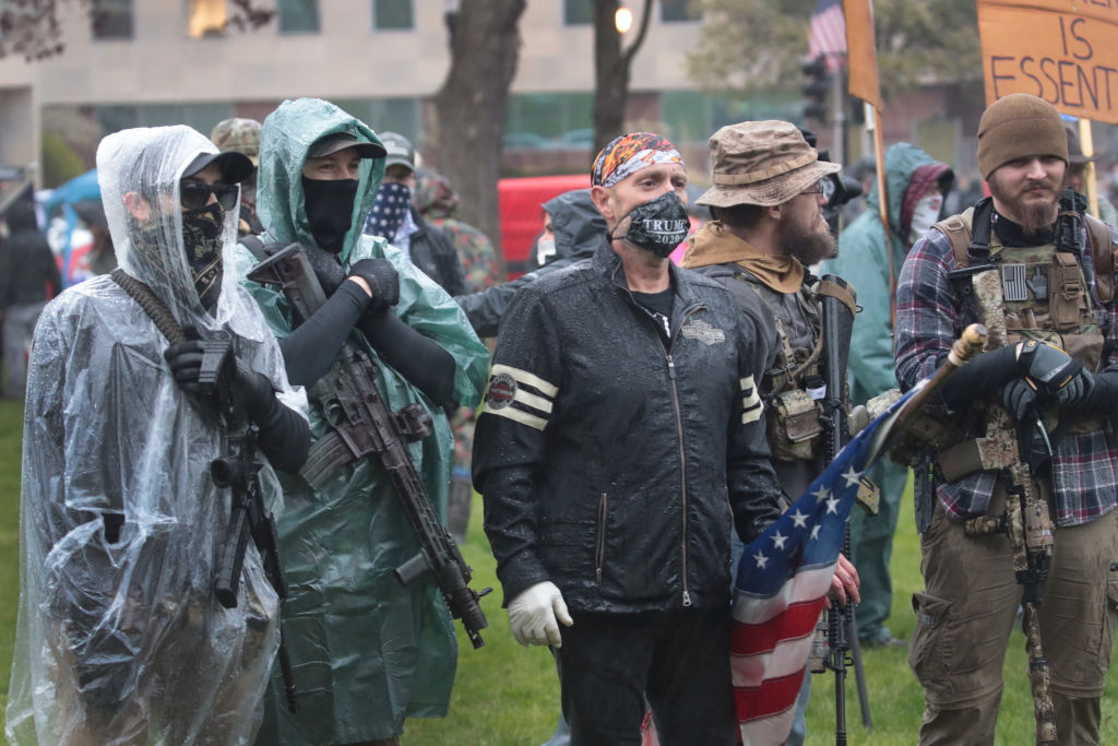 Hundreds of heavily-armed gun activists surround Michigan State Capitol