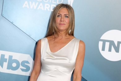 Jennifer Aniston Stomping Out Fire During Emmys